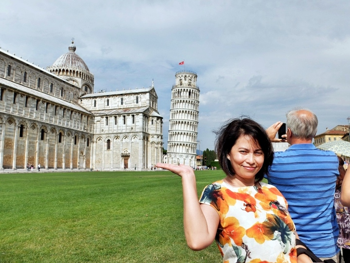 Doing the quintessential ' Leaning Tower of Pisa in the Palm of my Hand' selfie.