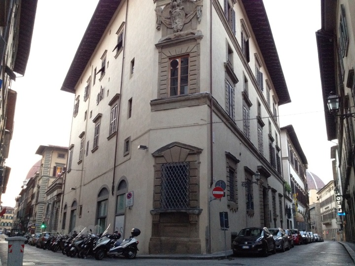 An interesting street with a beautiful irregular-shaped building that leads to The Duomo.